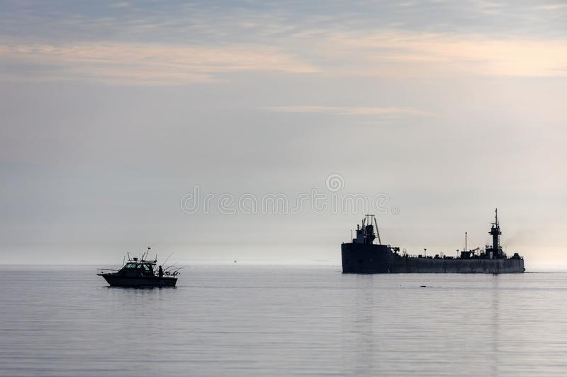 Manitowoc,WI, USA  August 31, 2019 : the ship sailing from Lake Michigan to the mouth of the Manitowoc River. Manitowoc,WI, USA  August 31, 2019 :Boat and ship stock photo