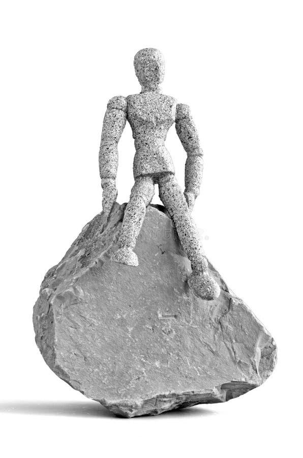 Mankin sur la roche images stock