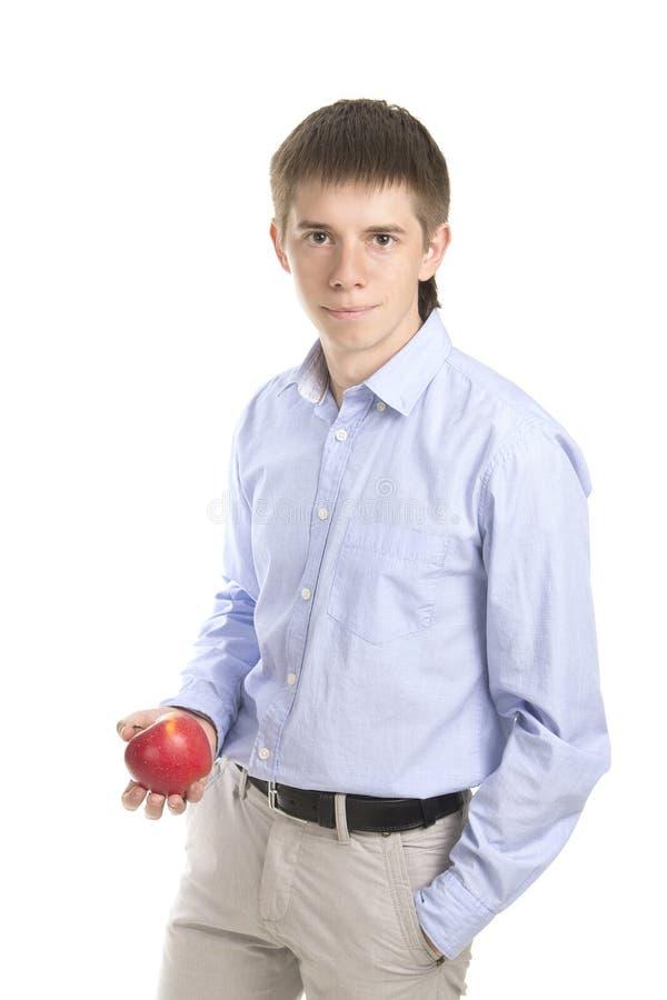 Manl держа желтое яблоко стоковые фото
