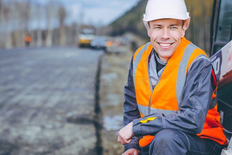 Manlig arbetarvägkonstruktion arkivbilder