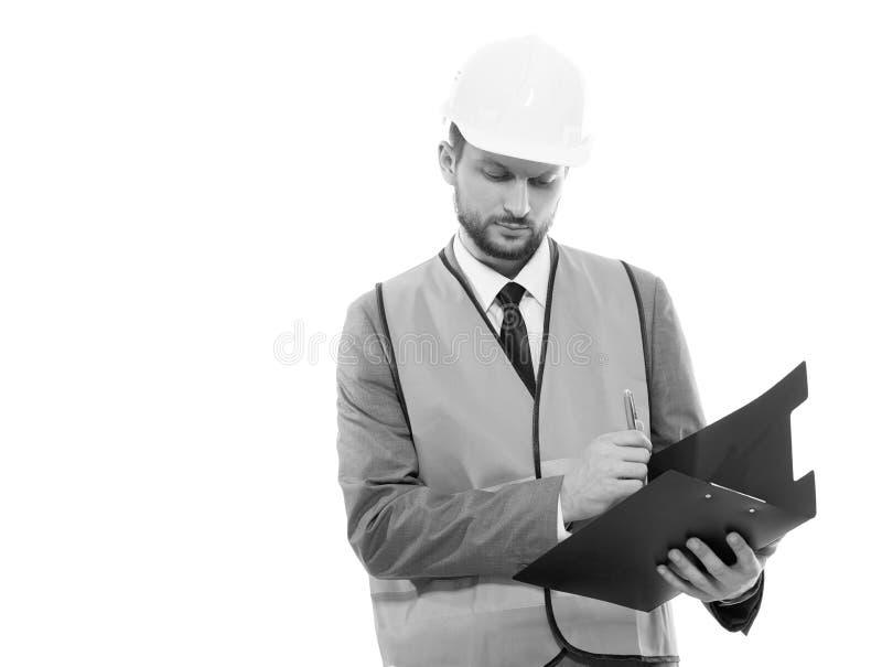 Manlig arkitekt i en västra säkerhet och en hardhathandstil på hans cli arkivbilder