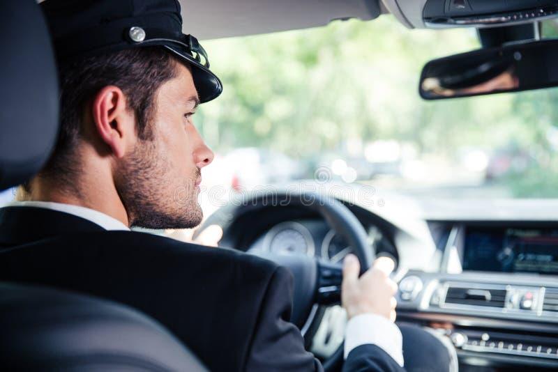Manlig chaufförridningbil fotografering för bildbyråer