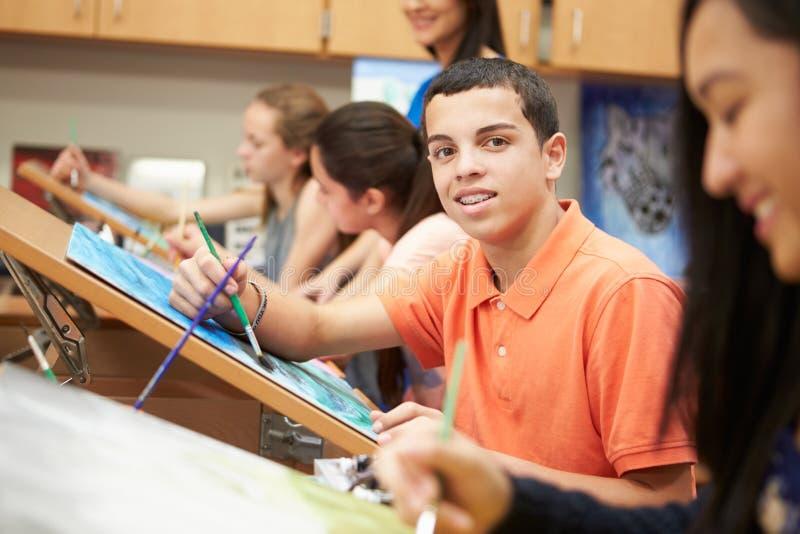 Manlig elev i högstadiet Art Class royaltyfria bilder