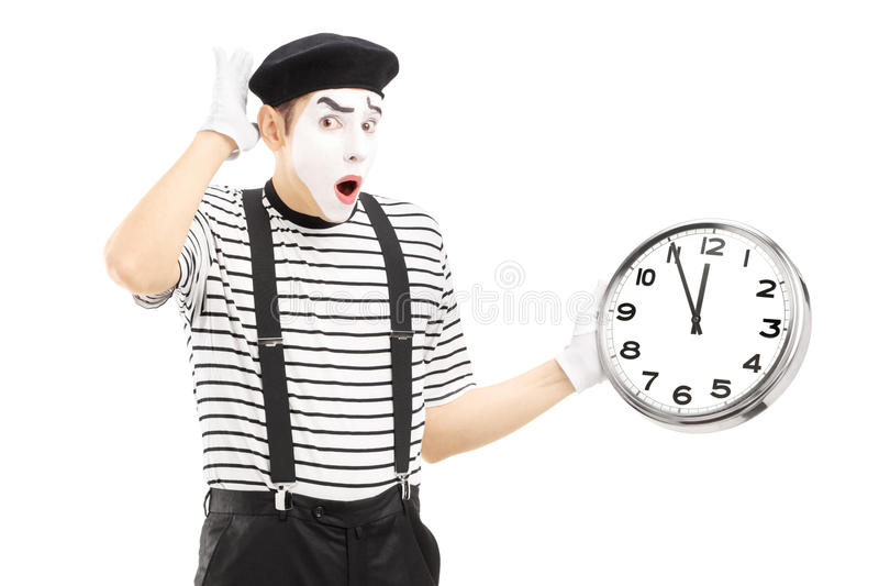 Manlig fars som rymmer en klocka och sent gör en gest arkivbilder