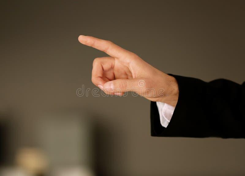 Manlig hand med att peka för finger royaltyfria bilder
