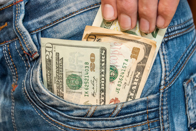 Manlig hand med dollar fotografering för bildbyråer