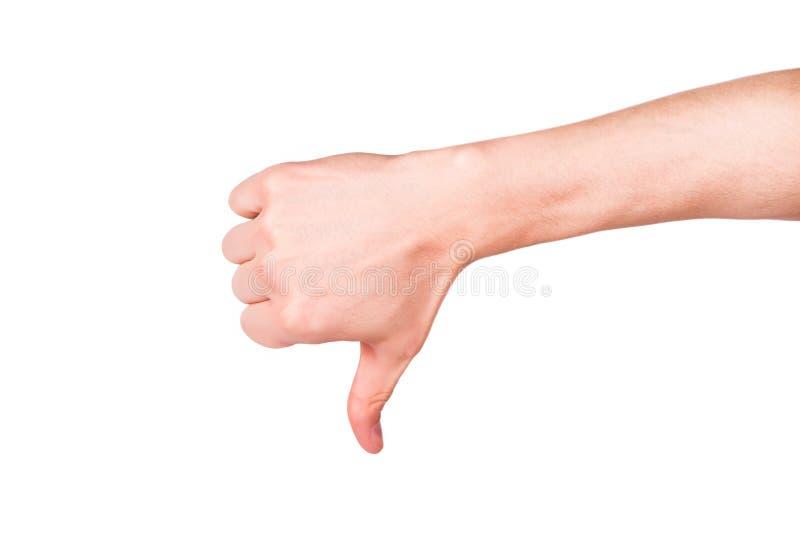 Manlig hand med en tumme ner. Negativ inställning, kuggningbegrepp fotografering för bildbyråer
