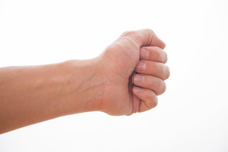 Manlig hand som beströr något fotografering för bildbyråer