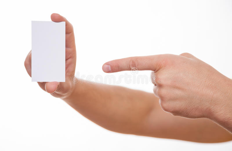 Manlig hand som indikerar ett tomt affärskort arkivfoton