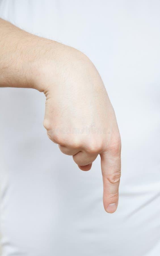 Manlig hand som ner indikerar fotografering för bildbyråer