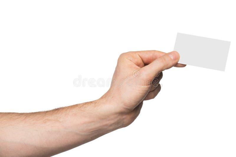 Manlig hand som rymmer det pappers- kortet arkivfoto