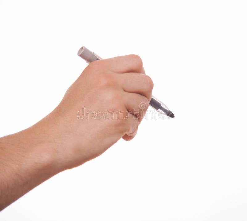 Manlig hand som rymmer en markör arkivfoton