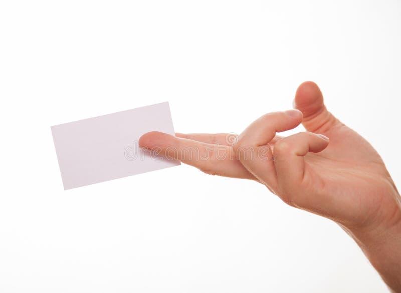 Manlig hand som rymmer ett tomt affärskort fotografering för bildbyråer