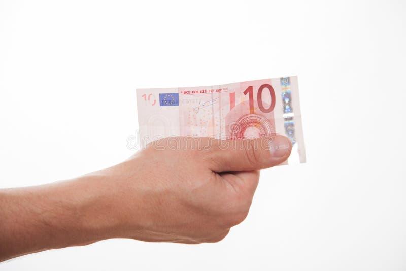 Manlig hand som rymmer euro tio fotografering för bildbyråer