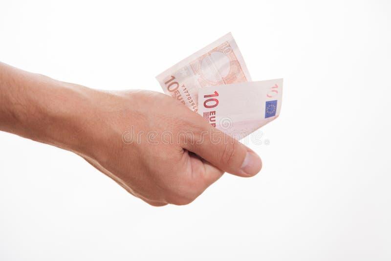 Manlig hand som rymmer euro tio royaltyfri bild