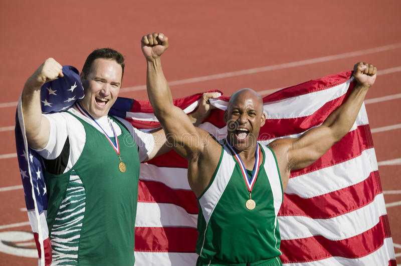 Manlig idrottsman nenWith Medal And amerikanska flaggan arkivbild