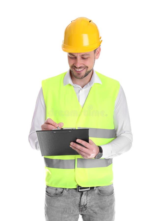 Manlig industriell tekniker i likformig med skrivplattan på vit bakgrund arkivbild