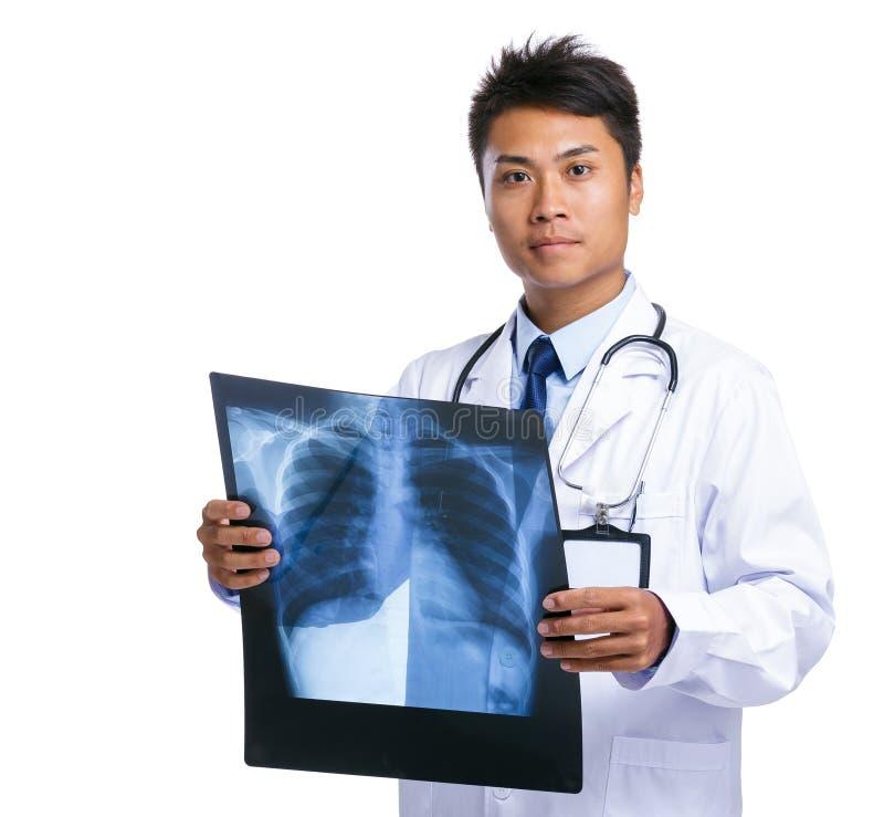 Manlig stråle för doktorshållx royaltyfri bild