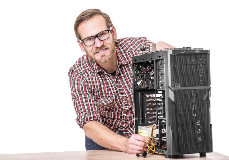 Manlig tekniker med datoren fotografering för bildbyråer
