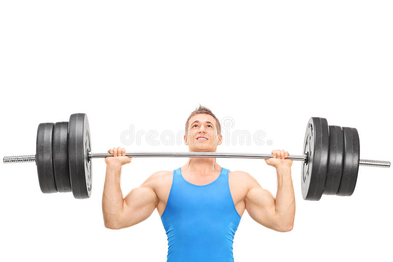 Manlig tyngdlyftningidrottsman nen som lyfter en tungvikt arkivfoton