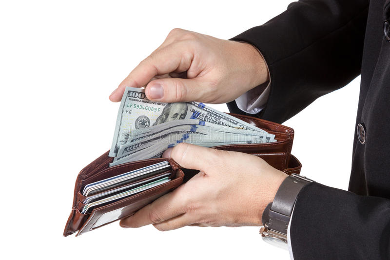 Manliga händer som får pengar från hennes handväska arkivbild