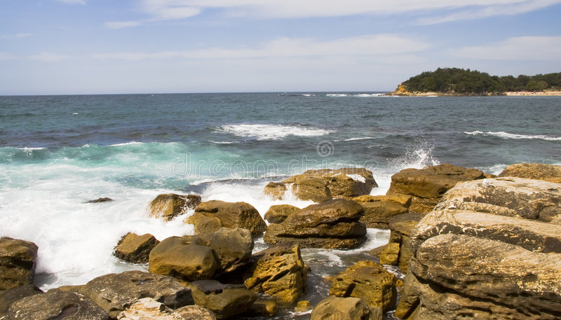 Manly Beach Rocks. Rocks with waves crashing against them at Manly Beach in Sydney, Australia royalty free stock images