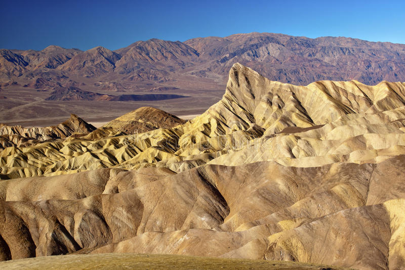 Manly Beacon Death Valley National Park. Zabriskie Point Manly Beacon Mudstones form Badlands Death Valley National Park California stock photo