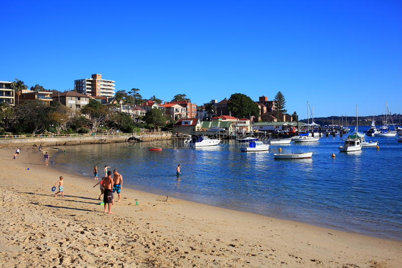Manly Cove beach Sydney. The famous Manly Cove Beach in Sydney, Australia, with people enjoying a warm and sunny winters day. City life at the beach stock photos