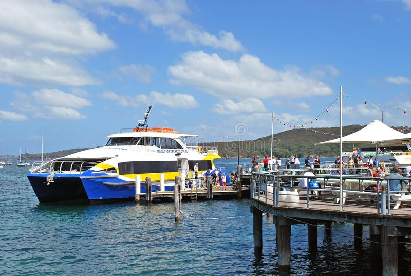 Manly Fast Ferry boat at Manly wharf ready to pick up passengers and depart to Sydney Cirqular Quay in the summer noon. Sydney, Australia - October 11, 2015 royalty free stock images