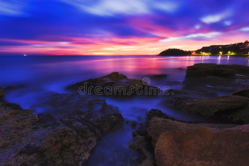 Manly Rocks Dark Pink East. Dark sunrise over Sydney pacific coast on north shore along North Head and manly beach sandstone rocks at low tide stock photos