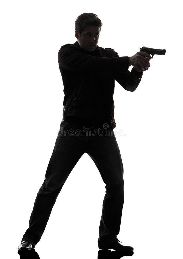Manmördarepolis som siktar den stående konturn för vapen fotografering för bildbyråer