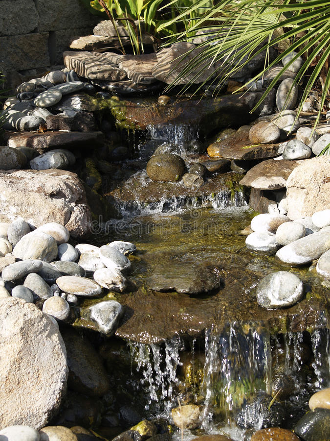 Manmade rock waterfall fountain pond outdoors moss stock for Green plants for landscaping