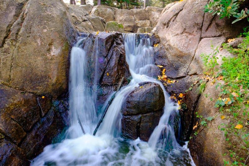 Manmade Waterfall Golden Gate Park. Golden Gate Park manmade waterfall near a large body of water stock photo