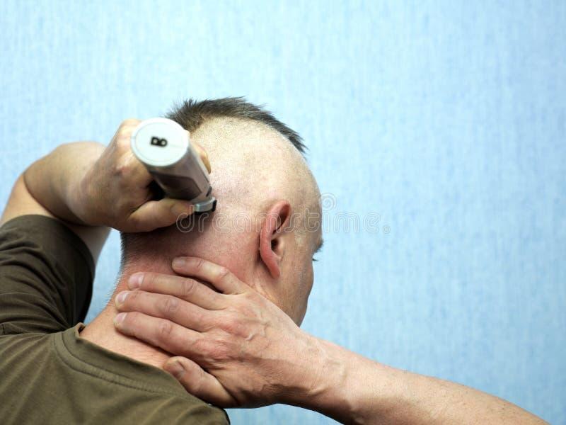 Mann-Ausschnitt-Haar lizenzfreies stockfoto