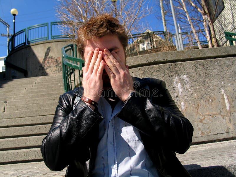 Mann-Bedeckung-Gesicht Stockbilder