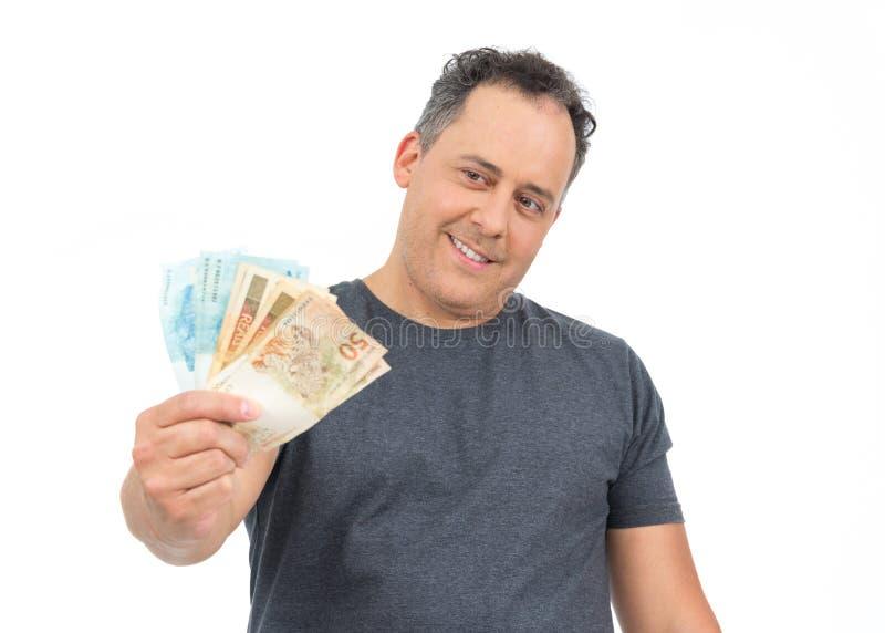 Mann betrachtet das Geld, das er erworben hat Er ist, hat overw kahl lizenzfreie stockbilder