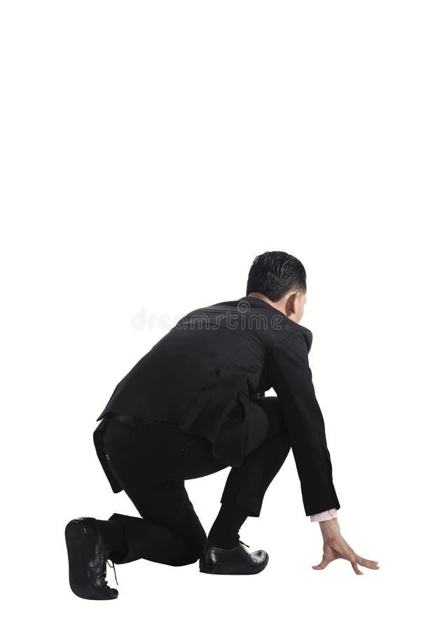Mann betriebsbereit zu laufen stockbilder