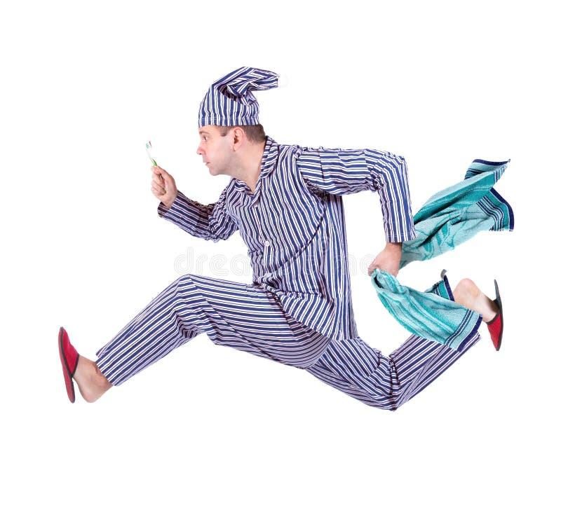 Mann in den Pyjamas stockfotografie