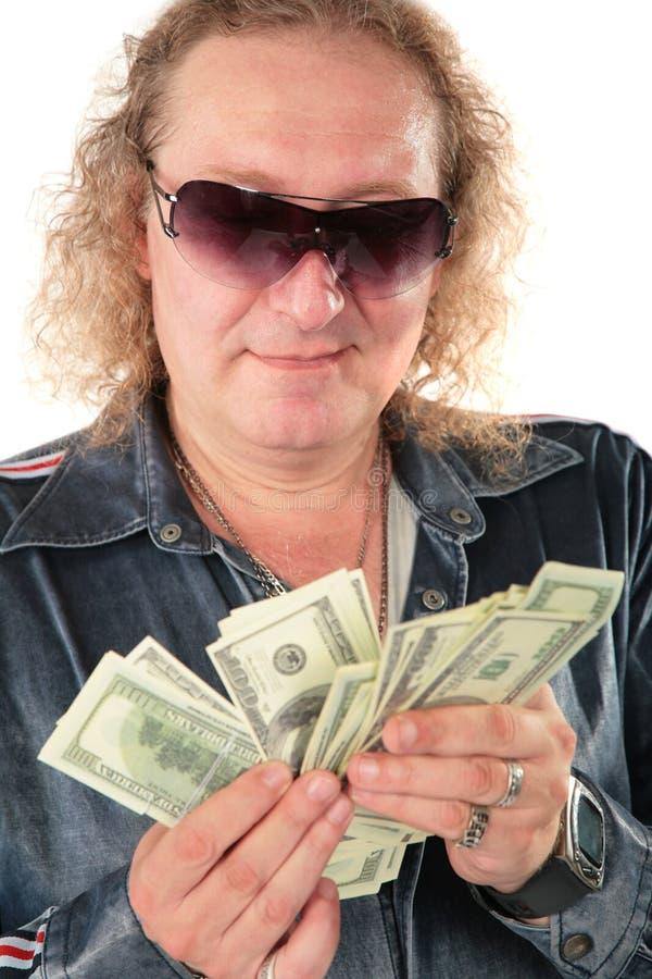 Mann in den Sonnenbrillen mit Dollar stockbild
