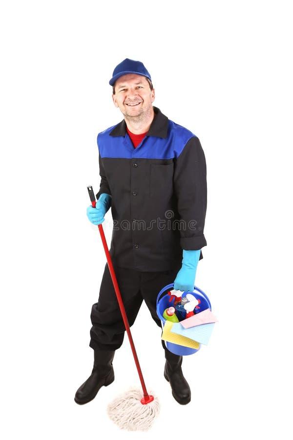 Mann in der Arbeitskleidung mit Eimer und Mopp. lizenzfreie stockfotos