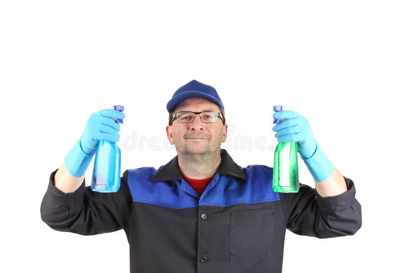 Mann in der Arbeitskleidung mit einem Spray stockfotos