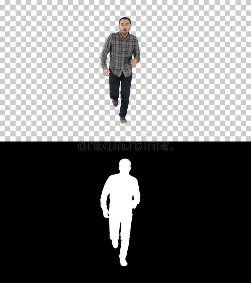 Mann, der beginnt, in zufällige Kleidung, Alphakanal zu laufen lizenzfreie stockfotos