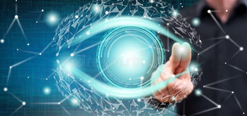 Mann, der ein digitales Augenkonzept berührt lizenzfreies stockbild