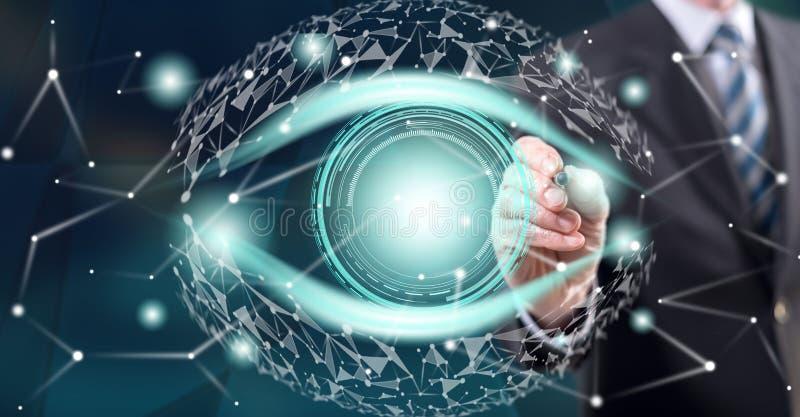 Mann, der ein digitales Augenkonzept berührt lizenzfreie stockfotos