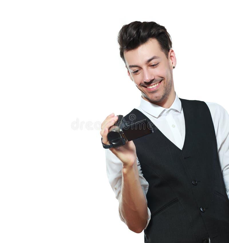Mann, der einen HD-Kamerarecorder hält stockbilder