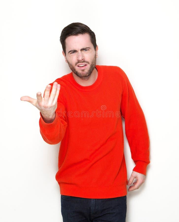 Mann, der Fragen mit der Hand angehoben stellt lizenzfreie stockbilder