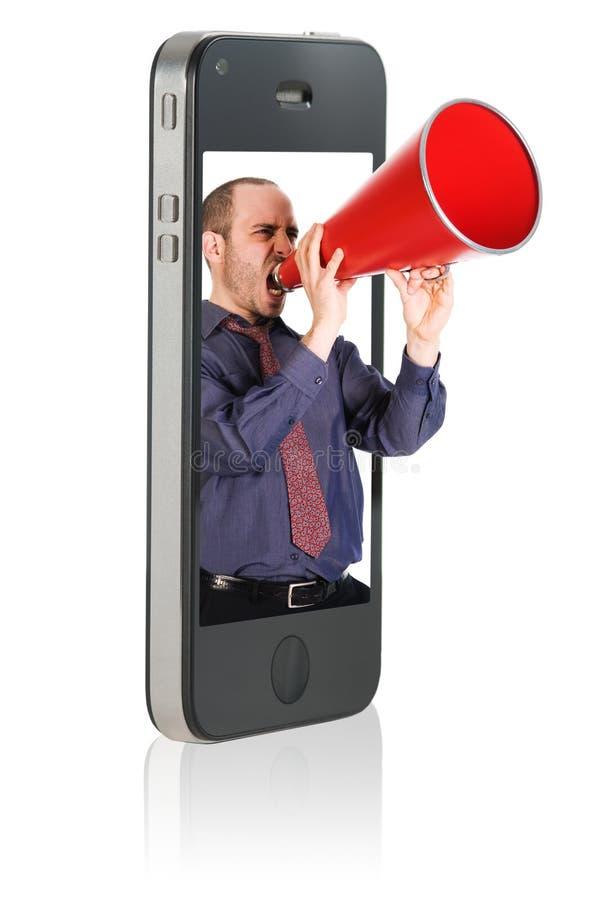 Mann, der im Megaphon kreischt stockfotografie
