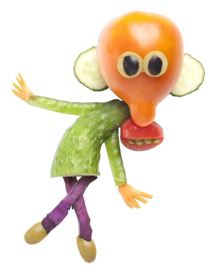 Mann in der lustigen Haltung gemacht von der Tomate und von der Gurke lizenzfreies stockbild