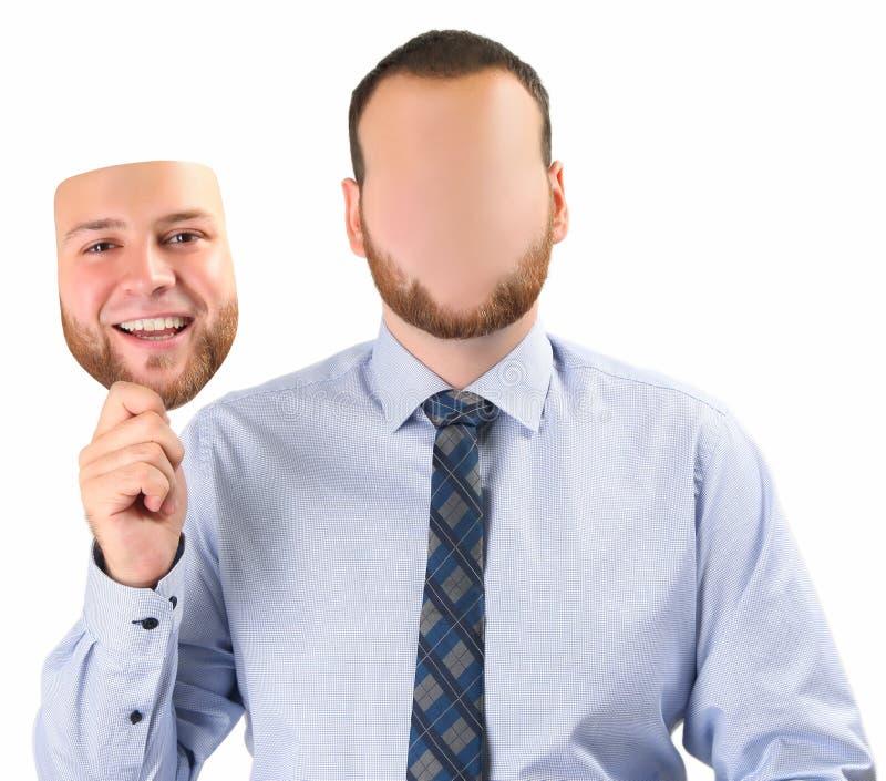 Mann, der Maske hält stockbilder