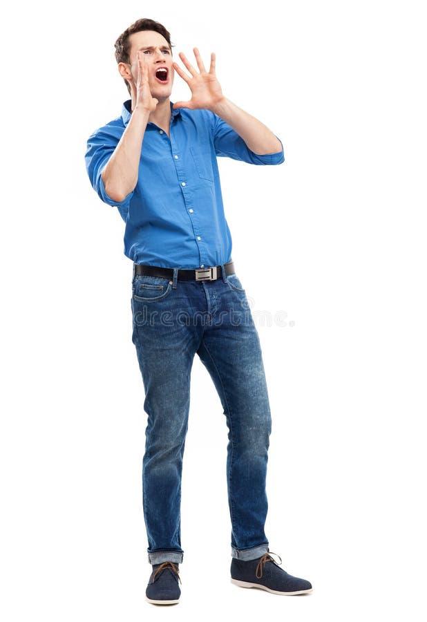 Mann, Der Mit Den Händen Nahe Seinem Mund Nennt Stockfotografie